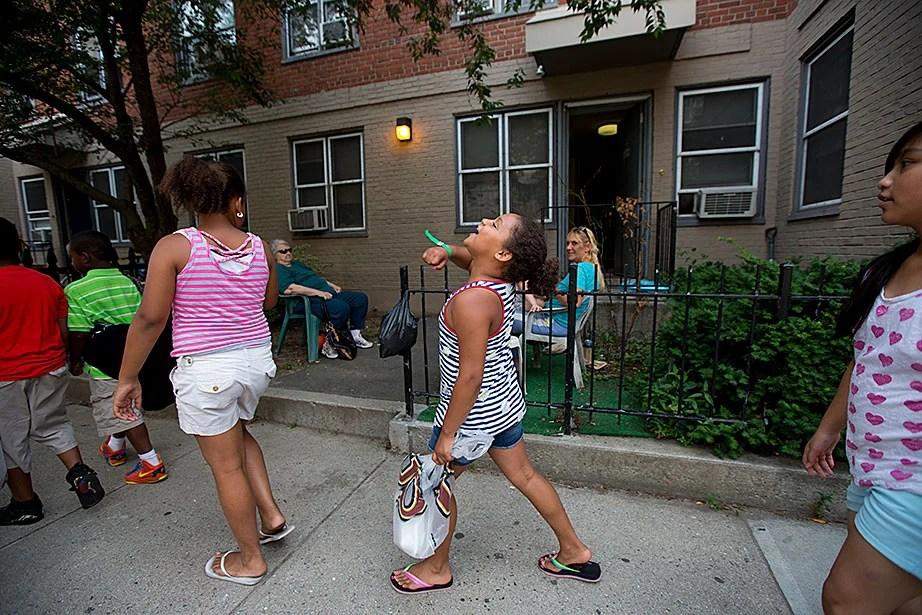 An especially exuberant Julia Perez sang as she walked along a Southie street.