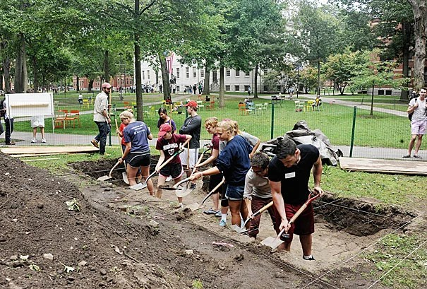 "Harvard College student Matthew DeShaw participated in the 10th annual Harvard Yard dig (photo 1), alongside Jeffrey Zhao '16 and Matthew C. Gschwend '16 (photo 2), which DeShaw said turned up ""a few pieces of coal, aggregates of rock, shards of glass, and an MBTA token"" (photo 3)."