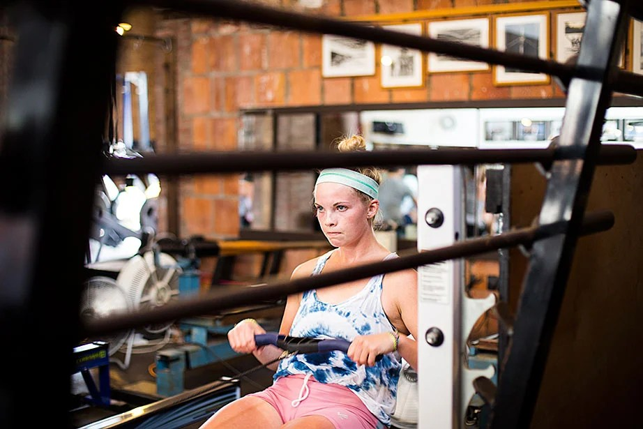 Lauren Tracey '16 works the rowing machine inside Weld Boathouse, where the Harvard women's heavyweight crew team prepared for the Head of the Charles race.