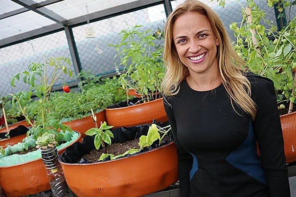 """Paulina Campos, M.P.P. '07 (photo 1), in a rooftop garden at Infonavit, the federal institute for worker housing in Mexico. She is CEO of Fundación Hogares, a nonprofit created by Infonavit to establish community-building programs in affordable housing developments. Laura Janka, M.A.U.D. '11 (photo 2), stands on top of the Torre Latinoamerica in Mexico City, where she is a city planner. Harvard gave her, she said, """"the freedom to imagine."""""""