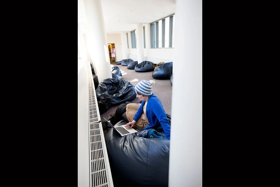 HLS student Anna Byers works in Beanbag Alley, located on the third floor of Langdell Hall.