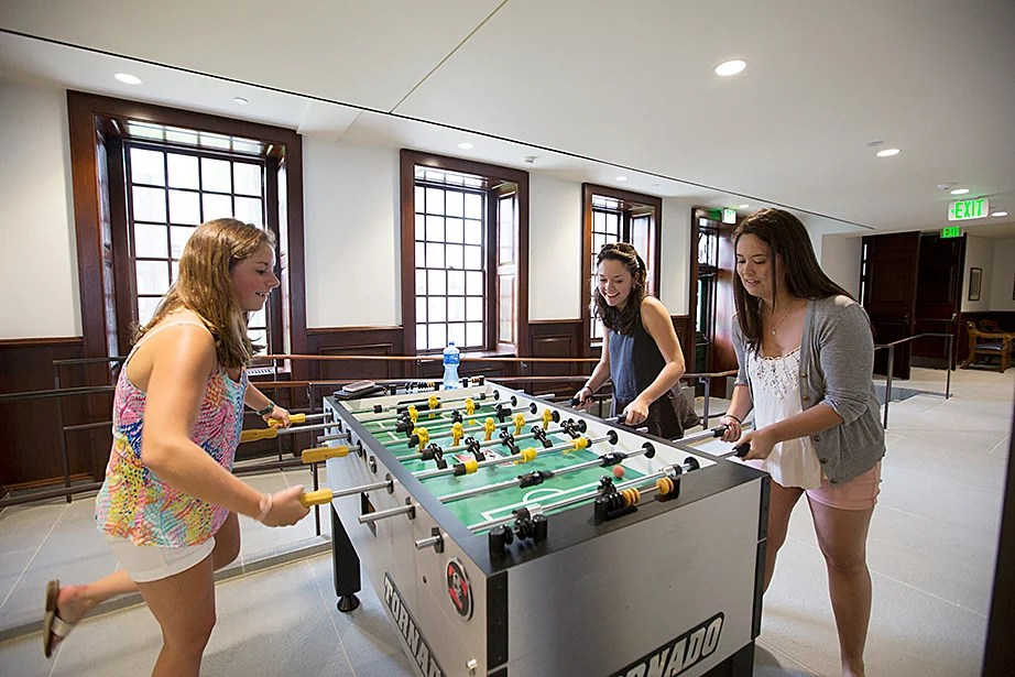 Undergraduates Megan McLaughlin '16 (from left), Joan Timmins '16, and Christine Cahill '16 are pictured inside McKinlock Hall. Rose Lincoln/Harvard Staff Photographer