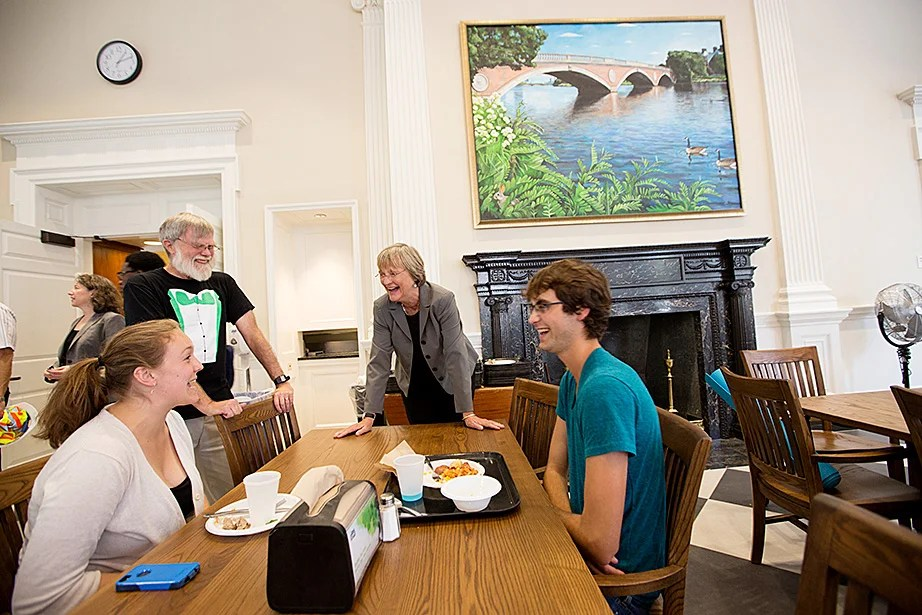 Harvard President Drew Faust and Leverett House Master Howard Georgi speak with residents Teagan Lende '16 and Alice Hyde '16 in McKinlock Hall. Rose Lincoln/Harvard Staff Photographer