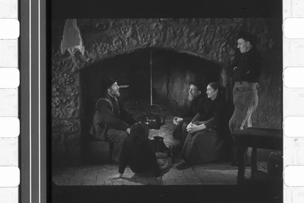 """""""Oidhche Sheanchais"""" (""""A Night of Storytelling"""") by pioneer film documentarian Robert J. Flaherty used a hearthside set and featured the cast of """"Man of Aran"""" (1935). The only known print of the 1935 short, the first """"talkie"""" in Gaelic, was rediscovered at Houghton Library, restored, and will have its U.S. premiere during """"The Lost Worlds of Robert Flaherty,"""" a Jan. 30–March 1 Harvard Film Archive series."""