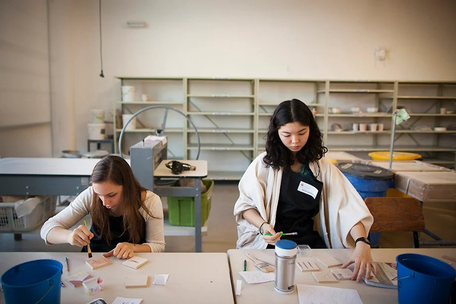 Brittany Liebenow (left) and Jamie Lee Solimano '17 explore a variety of print-making techniques on clay. Stephanie Mitchell/Harvard Staff Photographer