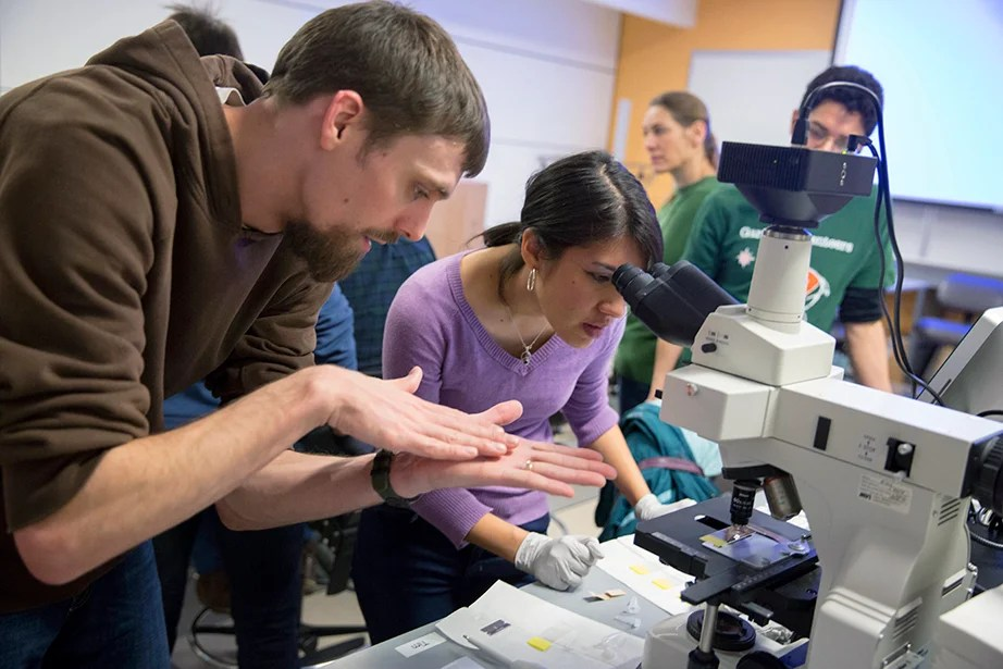 Acting as co-instructor, postdoctoral student Nick Lyons teaches GSAS student Denise Sirias during the MSI Graduate Consortium, a weeklong intensive. The theme of the workshop was microscopy, providing students an opportunity to learn techniques and capture images of microbes in various edible microbial products (e.g., cheese, yogurt, beer, kombucha, and sauerkraut). Kris Snibbe/Harvard Staff Photographer