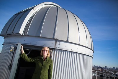 Sarah Rugheimer, a doctoral student in astrophysics, stands near the telescope atop the Science Center roof. She is investigating how to probe distant planets for signs of life.