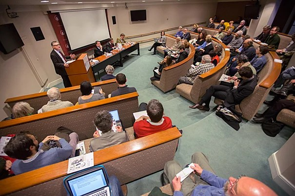 """Optimists think there will be an end to the Greek drama. I don't share that optimism,"" said Dimitris Keridis (seated, left), associate professor of international relations from Panteion University in Athens. His fellow panelists, Dante Roscini, professor of management practice at HBS, and Sir Paul Tucker, senior fellow at HKS and HBS, shared the sentiment with their own testimonials on Greece's morbid state of affairs."