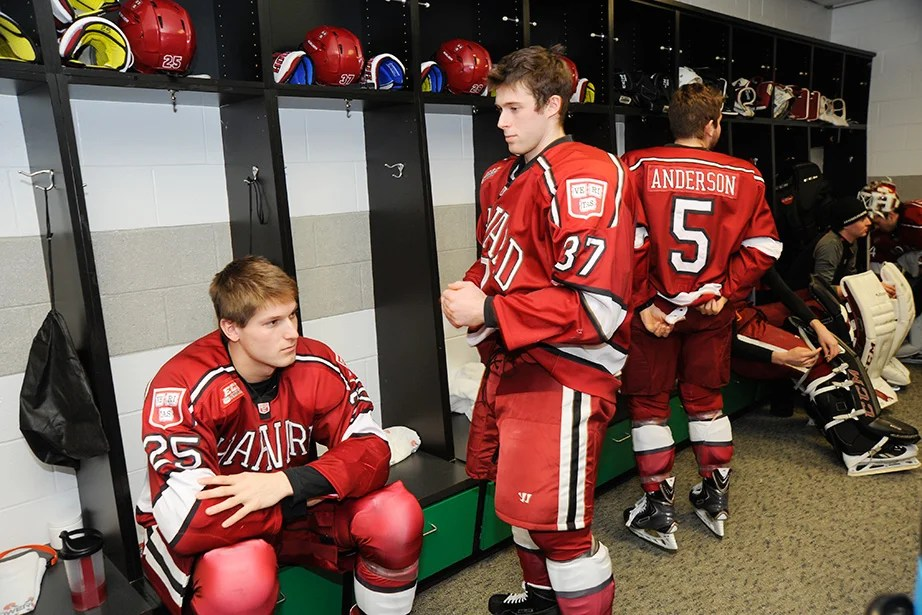 Crimson players Wiley Sherman '18 (from left), Desmond Bergin '16, and Clay Anderson '17 take a few quiet moments as they prepare to take the ice against their crosstown rivals Boston University in the Beanpot opening round. Jon Chase/Harvard Staff Photographer