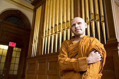 """""""In this culture, people like to give a hug in friendship, but monks don't do that. We don't even shake hands,"""" said Bhante Kusala (photo 1), who is studying at the Divinity School. Buddhist nun Chang Gan Shi (photo 2) and fellow monk Ishwor Shrestha (photo 3) join Kusala in the Cambridge culture."""