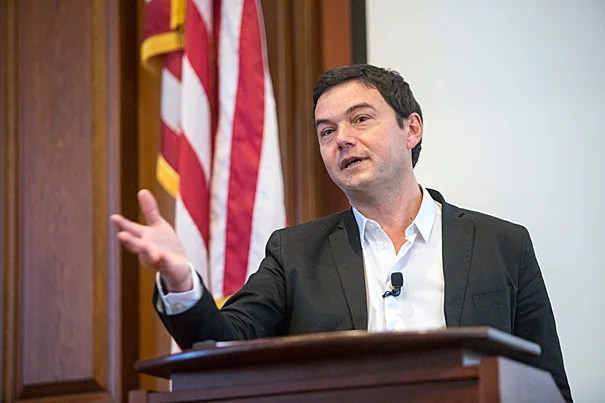 Noted French economist Thomas Piketty spoke before an overflow crowd inside Austin Hall at Harvard Law School, touching on his bestselling book's widely critiqued equation for explaining growing income inequality.