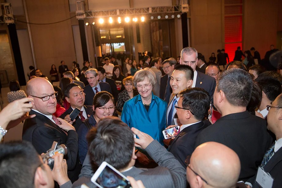 Harvard President Drew Faust is flanked by faculty and friends after speaking at a Your Harvard alumni event in Beijing.