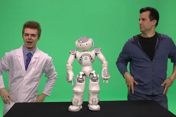 """David Malan (right, photo 1), Gordon McKay Professor of the Practice of Computer Science, technologist Colton Ogden from CS50/CS50x, and a special robotic guest incorporated live broadcasts into their MOOC, """"Introduction to Computer Science."""" While engaging thousands of global learners online, a research report suggests that MOOCs, such as """"Visualizing Japan,"""" have had equal if not greater influence on enhancing residential learning and empowering teachers with novel content and tools (photo 2)."""