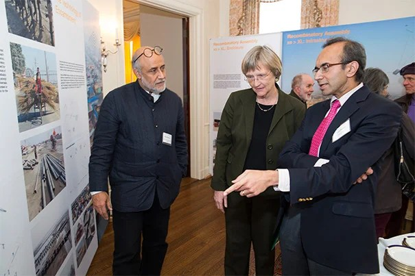 """The Harvard Kumbh Mela team gathered at Loeb House to reflect on the experience and to launch a book and exhibit on their findings, """"Kumbh Mela: Mapping the Ephemeral Megacity."""" Professor of Urban Design and Planning Rahul Mehrotra (from left), President Drew Faust, and Tarun Khanna, director of the South Asia Institute, discussed the exhibit. Khanna, born in India, set aside his professorial mien when he took his parents to the festival and took a ritual bath in the river water."""