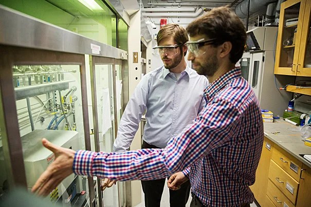 A new, first-of-its-kind technique developed by Bobby Day (left) and Max Mankin, graduate students working in the lab of Charles Lieber, the Mark Hyman Jr. Professor of Chemistry, could have applications in areas ranging from consumer electronics to solar panels.