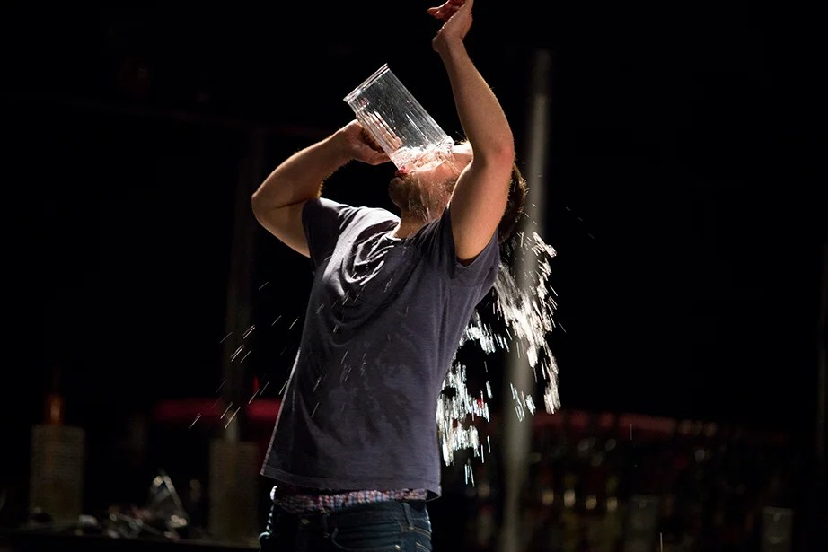 Max McGillivray '15 doesn't mind getting drenched during a scene. Stephanie Mitchell/Harvard Staff Photographer