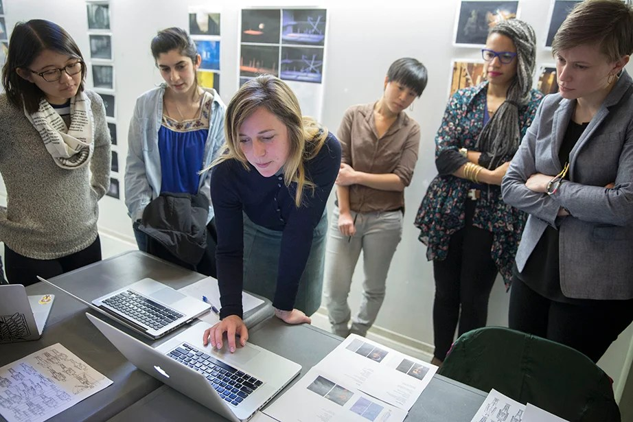 """Guan-Yue Chen '17 (from left), Chrissy Rodriguez '15, Harvard Graduate School of Design (GSD) students Stephanie Hsia, Lara Mehling, and Shaunta Butler, and instructor Sara Brown during a critique of student projects in """"Dramatic Arts 136: Scenography Studio."""" Kris Snibbe/Harvard Staff Photographer"""
