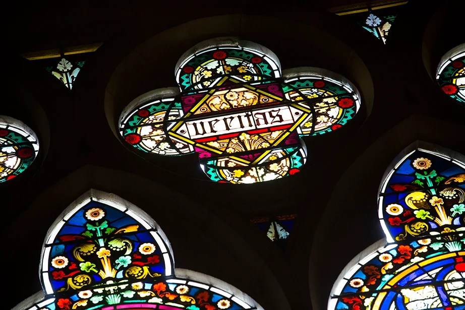 In the transept of Memorial Hall, a Veritas shield in stained glass.