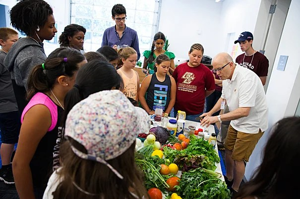 "The annual ""Science and Cooking for Kids"" program brought former White House pastry chef Bill Yosses (left) back to campus to teach students various cooking techniques and how to connect food with math and science."