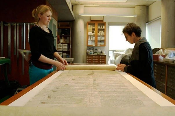 "Students taking ""The Book,"" a modular MOOC developed through HarvardX, will get unprecedented digital access to Harvard's archives of printed material. Among the holdings is a 39-inch scroll from the 15th century (photo 1). The course was conceived by Professor Jeffrey Hamburger (photo 2). Professor  Ann Blair (right, photo 3) and Meredith Quinn are filmed during a segment on Islamic manuscripts."