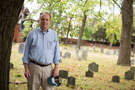 Executive Director of the Cambridge Historical Commission Charles Sullivan (pictured) tours through the Old Burial Ground in Harvard Square where numerous notable Harvard figures are buried. Stephanie Mitchell/Harvard Staff Photographer