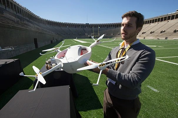 Brandon Landry (photo 1), from the West Coast-based Matternet, and John Aleman (photo 2), from drone manufacturer CyPhY, led demonstrations of their drones to a packed, yet protected, Harvard Stadium crowd (photo 3).
