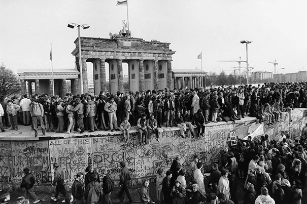 Some of Barbara Klemm's historic images include the fall of the Berlin Wall (photo 1), a fraternal kiss between Leonid Brezhnev and Erich Honecker (photo 2), and the opening of the Brandenburg Gate, Berlin (photo 3).