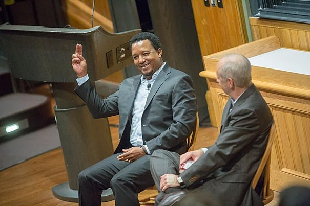 """I became a lot wealthier than I was when I was in the shack, for sure, but I don't know that I would trade my childhood for probably any other,"" retired Boston Red Sox pitcher Pedro Martinez told Harvard Professor Michael Sandel. ""My struggles made me appreciate every little success I had in my career."" Martinez responded to a request and demonstrated a pitching technique during the talk."