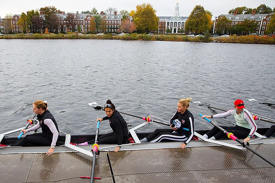 With Harvard Business School as a backdrop, rowers return to Weld Boathouse.
