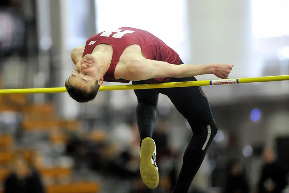 Spencer Lemons '16 clears the high jump bar. Lemons won the event with a leap of 6 feet 6.25 inches (1.99 meters), tying a season high.