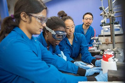 Undergraduates Anumita Das '16 (from left), Similou Akintorin '16, and Terilyn Chen '16 and teaching fellow David Wu test the effectiveness of biodiesel made from used vegetable oil from Annenberg Hall.