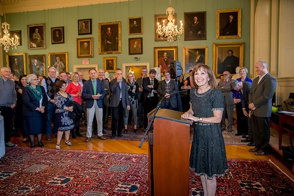 Accolades were bestowed upon Diana Sorensen (at podium), who is stepping down as Harvard's dean of arts and humanities. In the 10 years since being appointed, Sorensen has supported nearly a dozen new and enhanced curricular and outreach efforts.