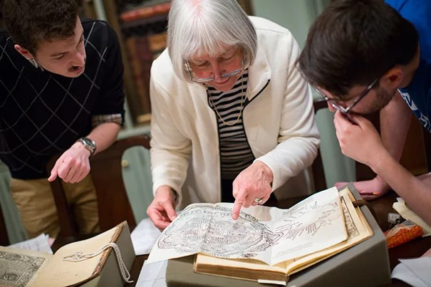 """On the 400th anniversary of Miguel de Cervantes' death, Professor Mary Gaylord brought two of her grad students,  José Ángel De León (left) and Rodrigo del Rio, to Houghton Library to see works related to Cervantes, the author of """"Don Quixote de la Mancha."""""""