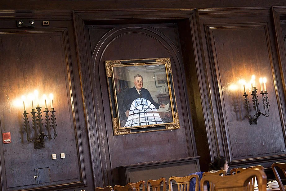 Boasting beautiful light, the Adams House dining hall is an elegant combination of structure and function. The walls are adorned with portraits, including Henry Hubbell's rendition of Franklin D. Roosevelt, who resided in Adams House from 1900–1904.