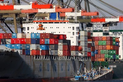 A container ship owned by a Chinese company is unloaded in Newark, N.J., in 2006. The World Trade Organization will hold a conference at Harvard Law School to discuss the future of international trade agreements.