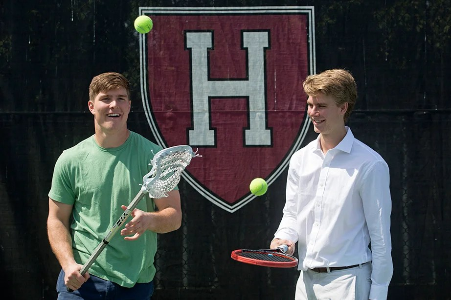 Beau (left) and Nicholas Bayh '18 juggle balls with sticks from their respective sports. Beau is on the lacrosse team, while Nick plays for a competitive club tennis team at Harvard. Jon Chase/Harvard Staff Photographer