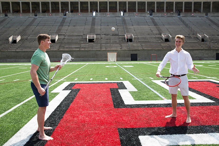 Harvard sophomores Beau (left) and Nicholas Bayh toss a ball on the turf at Harvard Stadium. Jon Chase/Harvard Staff Photographer