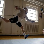 Harvard sophomore Eli Dershwitz (left) is poised for a medal run on Aug.10 as the youngest member of the U.S. Olympic men's fencing team.