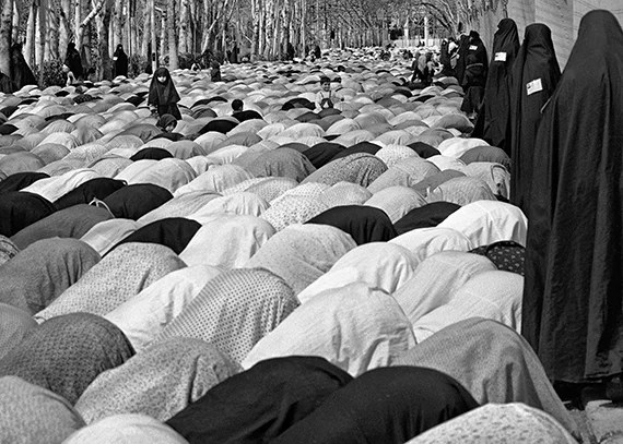 Women's Friday prayer service watched by female Revolutionary Guards.