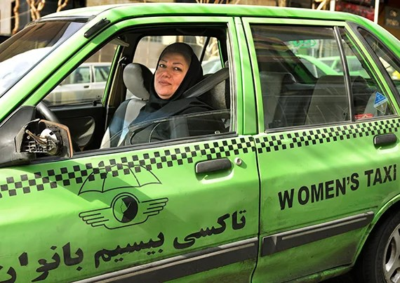 A Female taxi driver in Iran whose livery business exclusively caters to women.