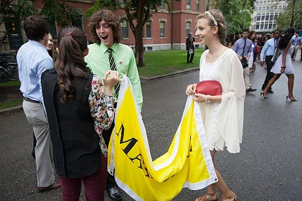 Harvard freshmen Nicky Hirschhorn, (from left, back to camera) Dylan Munro, (green shirt) and Molly Alter (right) enjoy Convocation in Memorial Church. Kris Snibbe/Harvard Staff Photographer