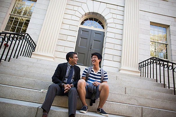 Dean of Harvard College Rakesh Khurana (left) speaks with Melvin Woo '19 on the University Hall steps. Stephanie Mitchell/Harvard Staff Photographer