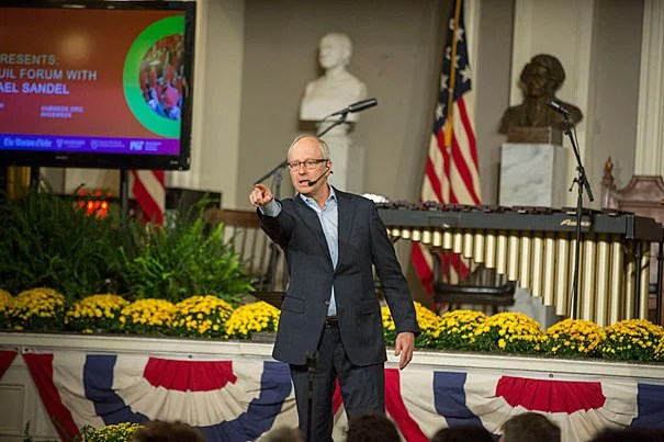 """Harvard Professor Michael Sandel addressed the Faneuil Forum audience as part of HUBweek. """"We're not going to debate about tax policy, Syria, emails, or the wall,"""" Sandel told the capacity crowd at Faneuil Hall."""