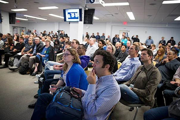 Audience members listen to Next GenerationSurgery & Rehab panelists, Jayender Jagadeesan, (BWH), Jeffrey Palmer and Ryan McKindles (MIT Lincoln Laboratory) present at VR/AR Industry Fair in the i-lab for Hubweek. Rose Lincoln/Harvard Staff Photographer