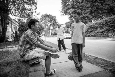 Incoming Harvard freshman, Kevin Yang with his brother, Neil Jin, outside their West Roxbury home. Their grandfather, Yongshou Jin, is in the background. Rose Lincoln/Harvard Staff Photographer