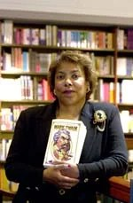 Jocelyn Chadwick, professor at the Graduate School of Education, with a copy of the complete works of Mark Twain. Chadwick is a Twain scholar and stands in defense of his work as a historical perspective on language and race, and is opposed to banning his work becuase of racial language that today is unaccepted. Photographed inside the Harvard Coop, Thursday, September 21, 2000. (Staff Photo Justin Ide, Harvard News Office)