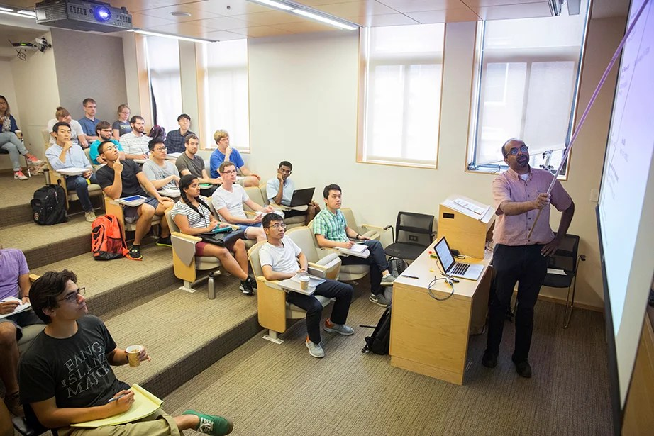 "L. Mahadevan teaches ""Fluid Dynamics"" in the Cruft Building. The course explores continuum mechanics; conservation of mass and momentum; energy, stress, kinematics, and constitutive equations; vector and tensor calculus; and dimensional analysis and scaling. Kris Snibbe/Harvard Staff Photographer"