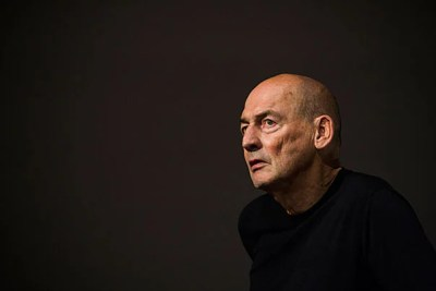 Architect Rem Koolhaas speaks to a Piper Auditorium audience of students and faculty about the political tensions in Europe and the radical futurism characteristic of his buildings.