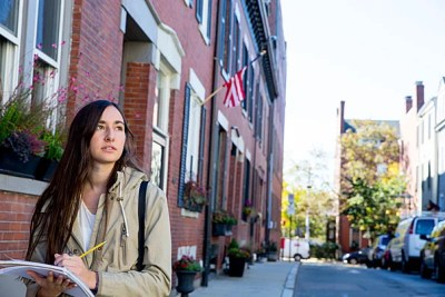 """Avila Reynolds '20 tours Charlestown to research income inequality in the neighborhood. """"The neighborhoods are so different and they're so close to each other,"""" she said. """"They're reflective of the income differences."""""""