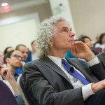 "Steven Pinker, Johnstone Family Professor of Psychology, listens during the symposium ""Behavioral Ethics"" at the Spangler Auditorium. Pinker took part in a panel discussion with philosophers Joshua Greene and Peter Singer to discuss what society can do to create more ethical behavior."